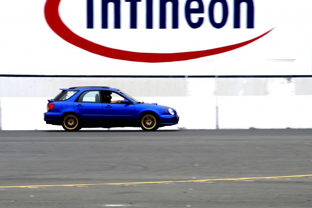 Andrew speeding by below the Infineon sign